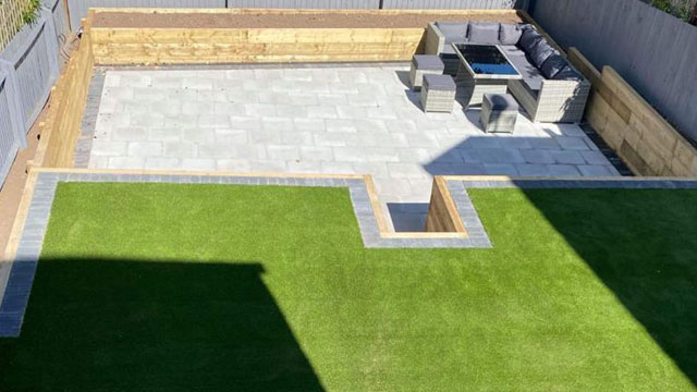 Rugeley patio with synthetic grass and sleepers